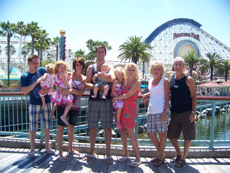 family in front of paradise pier